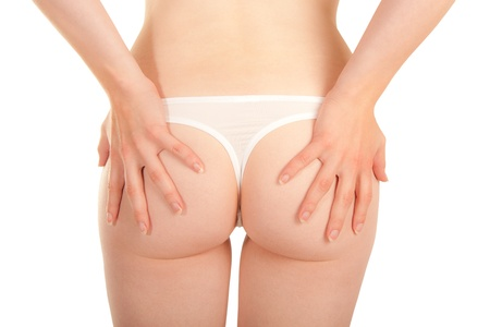 Bottom of a sexy young woman with white panties photo