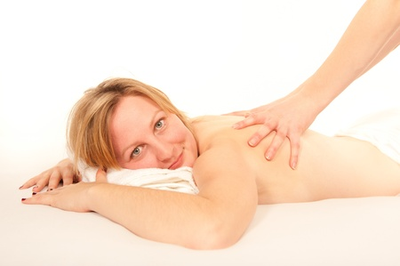 Sexy natural young woman receiving a massage in front of white background Stock Photo - 8324939
