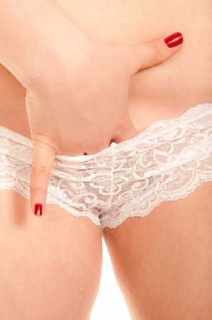 enticing: Finger of a sexy young woman inside white panties