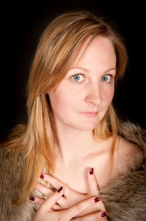 erotically: Portrait of a beautiful young woman with fur