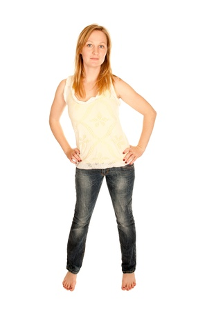 Sexy young woman in top and blue jeans, isolated on white photo