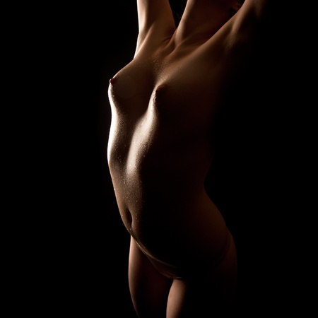 naked sexy girl: Naked wet body of a sexy woman in front of black background