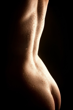 Sexy nude wet female body in backlighting Stock Photo