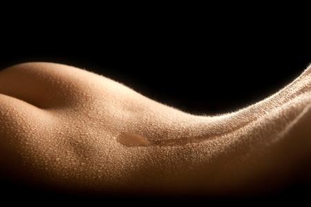 Delicate wet female body in back-lighting Stock Photo - 8802781