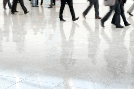 fast foot: Many business people in blurred motion in a fair hall