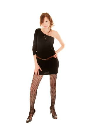 Full length portrait of sexy young woman with long legs and black dress, isolated on white
