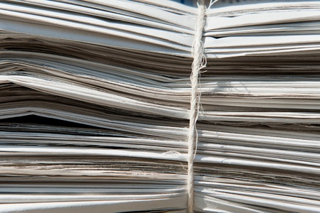 Closeup of a heap of old newspapers bound together
