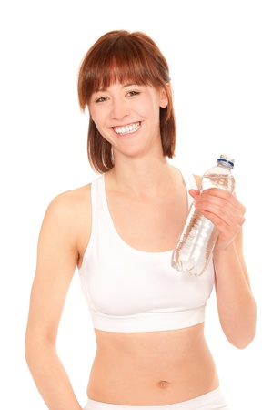 Beautiful athletic woman with bottle of mineral water, isolated on white photo