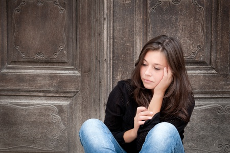 Outdoor portrait of a sad teenage girl looking thoughtful about troubles Stock Photo - 10056183