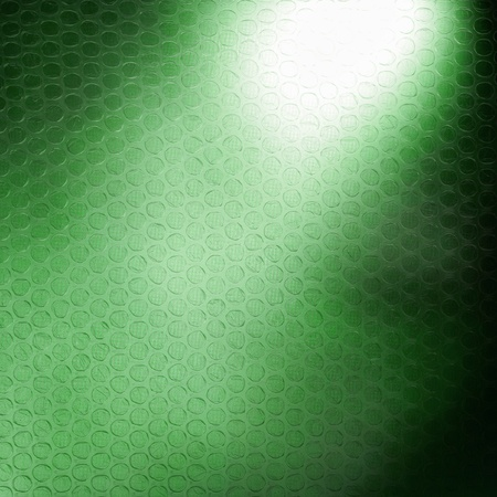 Abstract background, green plastic foil as a background motive photo