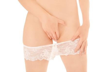 Beautiful slim woman taking off her black panties