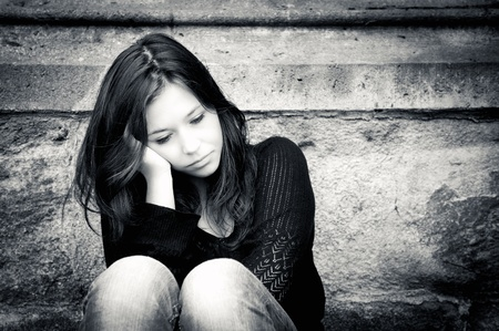 Outdoor portrait of a sad teenage girl looking thoughtful about troubles  Stock Photo - 10965991