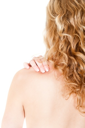 grabbing at the back: Rear view of a young woman holding her neck in pain, isolated on white background