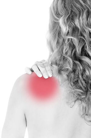 muscle tension tense: Rear view of a young woman holding her neck in pain, isolated on white background, monochrome photo with red as a symbol for the hardening Stock Photo