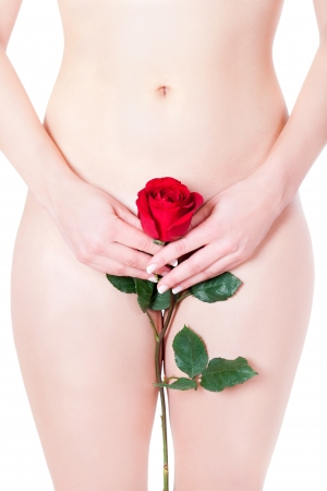 Closeup of a beautiful nude woman hiding her pubic region with a red rose, erotic concept, isolated front of white background Stock Photo - 12235979