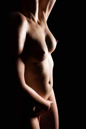 Wet body of a beautiful woman in front of black background Stock Photo - 13101537