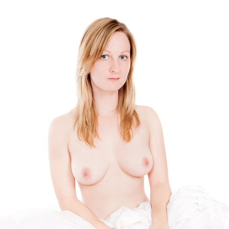 Portrait of a beautiful  blond woman sitting in bed photo