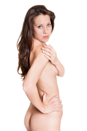 Beautiful nude brunette woman covering hear breasts with her arm, beauty concept, photo isolated on white background photo