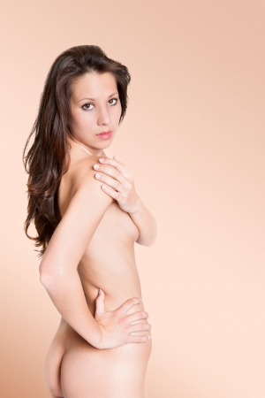 nude female buttocks: Fashion portrait of attractive nude brunette woman, beauty concept, photo in front of skin-colored background