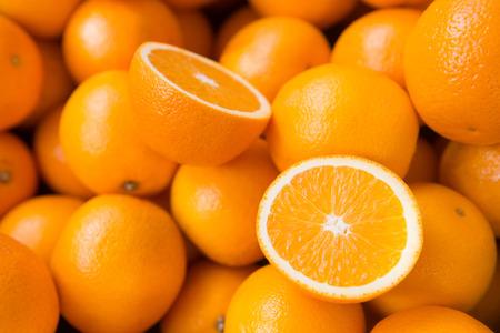 orange cut: Closeup of sliced oranges on a market