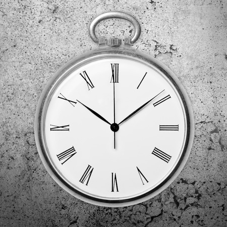 Antique golden pocket watch on grunge background, monochrome. Concept of time, past or deadline photo