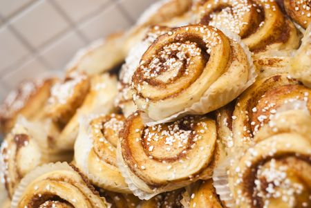 cinnamon swirl: A bunch of newly-baked cinnamon buns