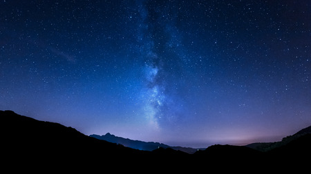 night sky panorama with moving stars and Milky way behind mountain Zdjęcie Seryjne - 34938101