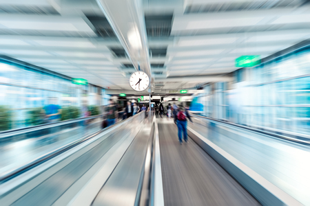 Airport terminal interior moving walkway. Fast motion blur effect. Time concept