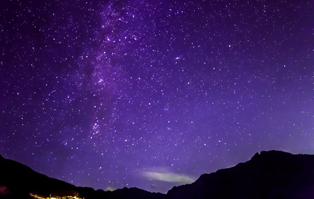 purple night sky stars. Milky way across mountains Stock Photo - 52686088