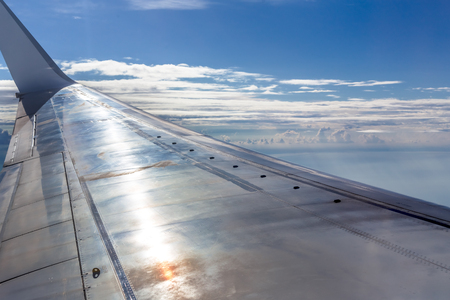 sky reflection: airplane win over sky sunset, metal reflection Stock Photo