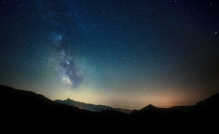 night sky stars with milky way on mountain background Imagens