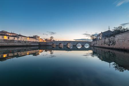 rimini: bridge sunset background. Twilight cityscape Rimini