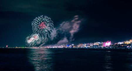 Fireworks explosion on adriatic sea riviera for celebrating Rimini Notte Rosa summer feast Imagens