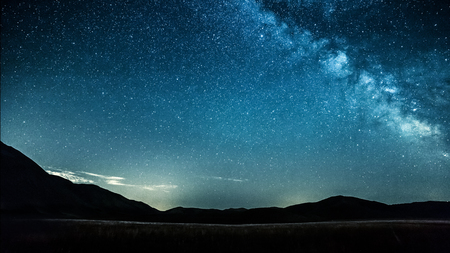 night sky with stars milky way over mountains