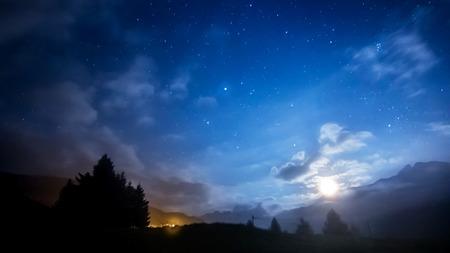 night sky stars and moon across mountain Stockfoto
