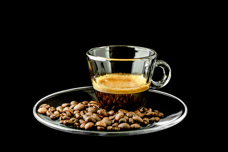 glass cup: espresso coffee in glass cup with roasted coffee beans Stock Photo