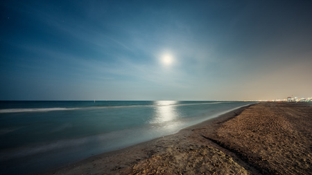a nocturne: Night summer sand beach with full moon. Seascape Stock Photo