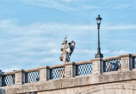 tevere: Rome street view sculpture Detail on Tevere bridge Stock Photo