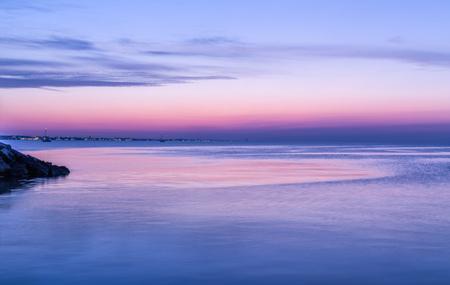 Amazing purple sunset over sea. Dusk landscape
