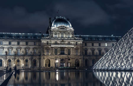 Paris, France - November 16, 2014: Night view of The Louvre museum with crystal pyramid. One of the most visited museum in the world.