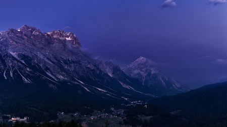 night mountain landscape. Italy Dolomites after sunset. Purple sky