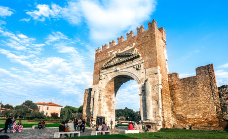 Rimini, Italy - september 23, 2012: Ancient Arco DAugusto (arch of Augustus). This is northern Italy's oldest surviving triumphal arch, marking the entrance to Rimini for travellers