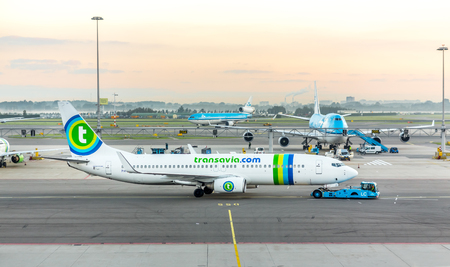 AMSTERDAM, NETHERLANDS - 08 SEPTEMBER 2014 : Transavia airlines boeing 737-700 taxiing at Schiphol Airport at sunrise . September 08, 2014 in Amsterdam, Netherlands.