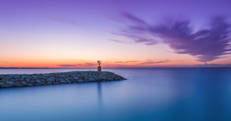 seascape sunset with purple sky and sea. Long exposure