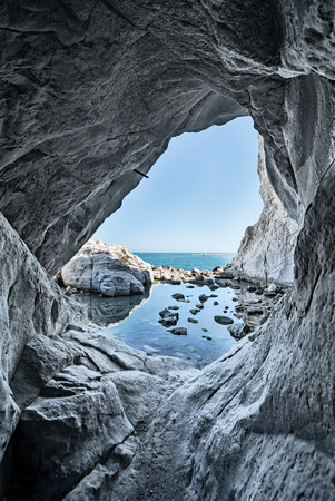 sea cave rocks. Grotto water reflections Imagens
