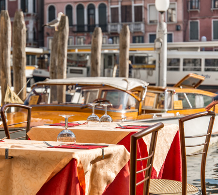 Venice touristic restaurant table on Grand Canal.