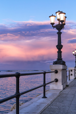 Bari seafront at sunset. Ancient original street lamp, amazing sky color. seascape.