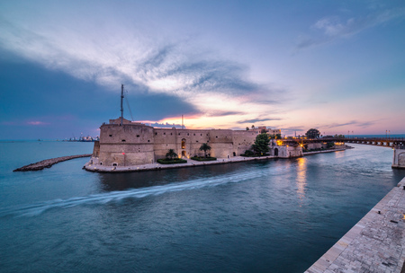 Taranto ancient fortress. Amazing sunset on city landscape. Italy panorama