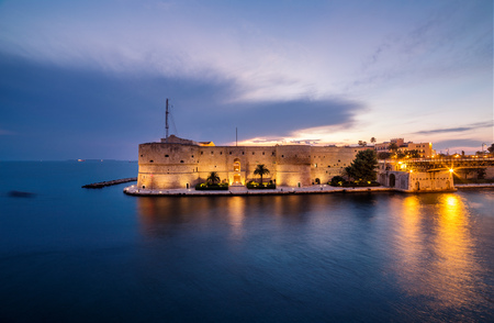 Night landscape of Aragonese Castle on seafront in Taranto. Italy amazing sunset