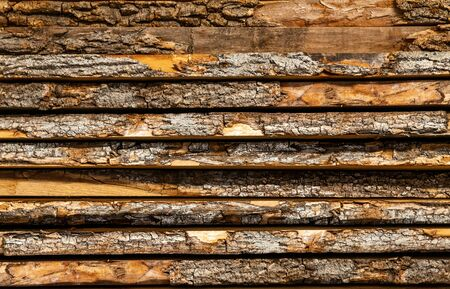 stack of wood. Detail of the bark of cut tree trunks. woodpile. Carpentry. texture pattern Zdjęcie Seryjne - 129411961